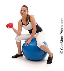 Working out on a pilates ball