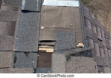 Wind ripped Shingles - Storm Damge to Roof and Shingles