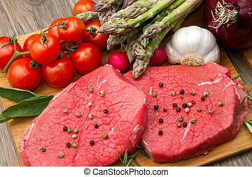 red meat with vegetables - raw meat with fresh vegetables