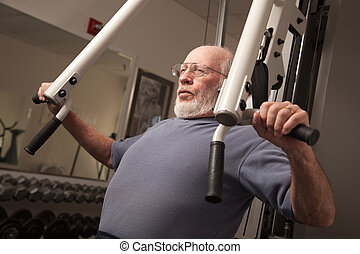 Senior Adult Man Working Out in the Gym - Active Senior...