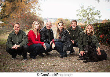 Attractive Family Pose for a Portrait Outdoors