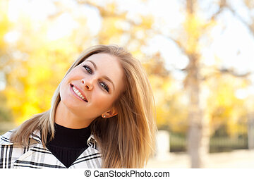 Pretty Young Woman Smiling in the Park