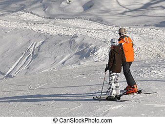 Skiers on a slope