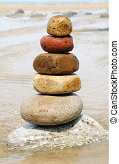 Stack of balanced rocks - Zen pebbles stacked together on...