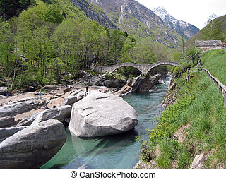 Ancient double arch stone bridge in Verzasca valley,...