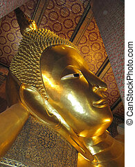 Golden statue of reclining Buddha in Wat Po temple