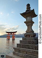 Miyajima Island - Gate (torii) and stone lantern of the...
