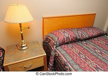 Hotel bed and lighted lamp