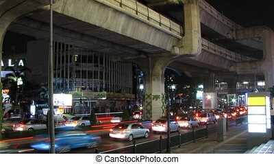 City traffic time lapse loop - Colorful city traffic time...