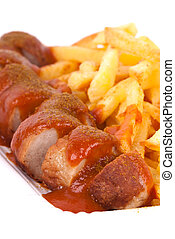 curried sausage and chips - a bowl with curried sausage and...