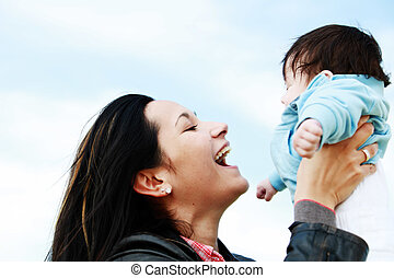 mother child happy - A young happy mother 22 years with her...