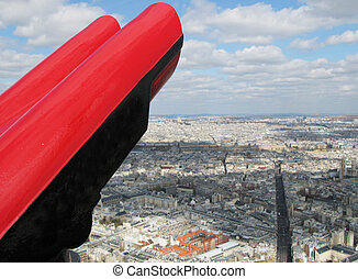 Binoculars against aerial panorama of Paris
