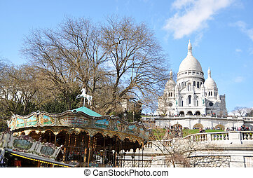 Old carousel and Basilique Sacre Coeur in Paris
