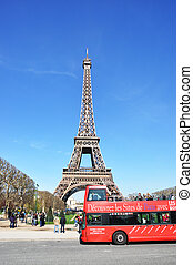 PARIS - APRIL 6: Excursion bus against Eiffel tower on April...