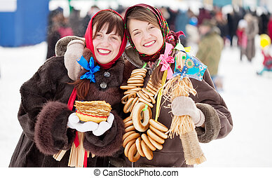Happy girls with pancake during Shrovetide - Happy girls in...