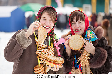 Women tasting pancake during Shrovetide - Women in...
