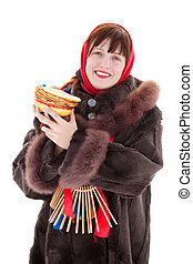 Woman in fur coat with pancake. Isolated over white