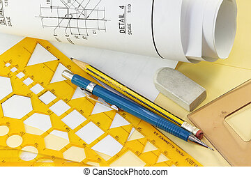 Rolls of architectural blueprints on a drawing table