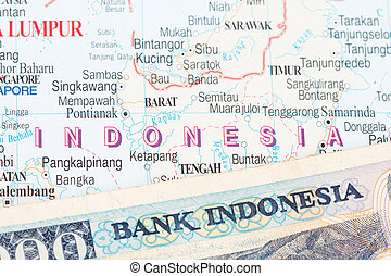 Indonesian rupiah close-up in an Indonesian map