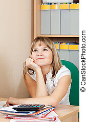 woman is dreaming on her workplace