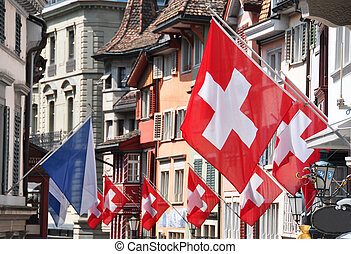 Old street in Zurich decorated with flags for the Swiss...