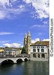 Zurich City Hall and Grossmuenster church across Limmat...