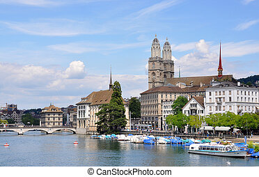 Zurich City Hall and Grossmuenster church across Limmat...