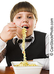 instant noodle - schoolboy eating chinese instant noodle...