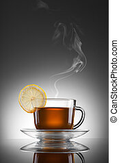cup of hot tea with lemon and steam