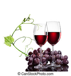 Red wine in glasses with grape and rod isolated on white