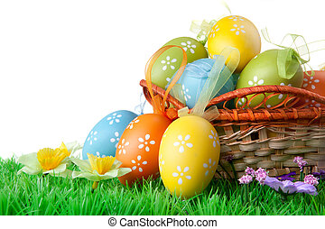 color easter eggs with green grass on the white