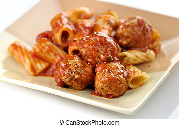 pasta and meatballs - Rigatoni with tomato sauce and...