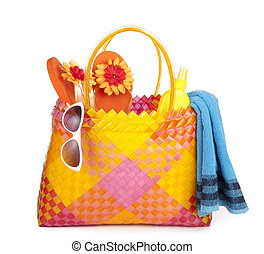 bag with beach items - colorful bag with beach items