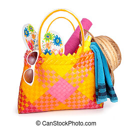 beach bag with towel sunglasses flip-flops and hat.isolated...