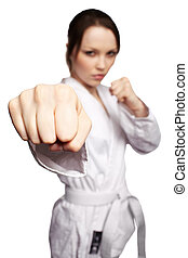 karate girl - low focus isolated portrait of beautiful...
