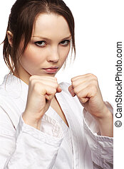 karate girl - isolated portrait of beautiful martial arts...