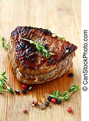 juicy sirloin beef with branches of thyme covered in pepper