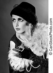 Retro styled fashion portrait of a young woman with pearls....
