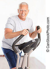 Gym & Fitness. Smiling elderly man  working out at home