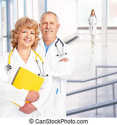 doctors - Smiling medical doctors with stethoscopes. Over...