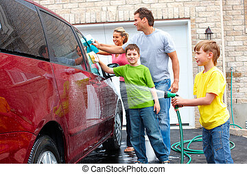 Family car - Smiling happy family washing the family car