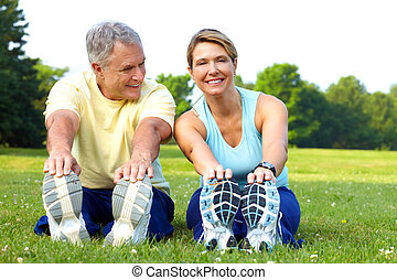 seniors fitness - Happy elderly seniors couple working out...