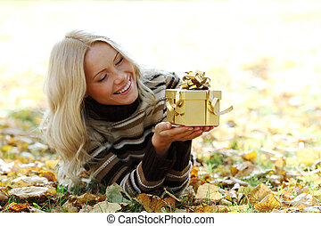woman take autumn gift in park