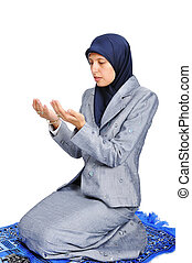 Young muslim woman praying on traditional way