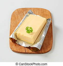 Block of fresh butter on a cutting board
