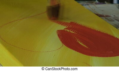 Heart shape - Painting a red heart on a canvas.