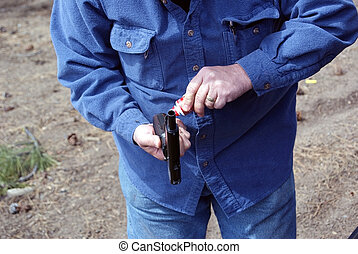 Oiling 45 before shooting - Giving the 45 caliber pistol a...