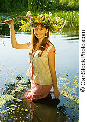 girl  in russian traditional clothes in river