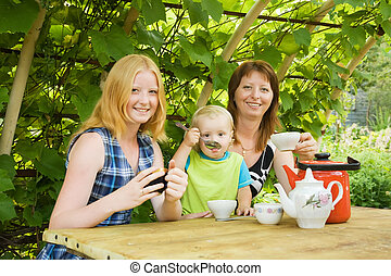 mother with children having tea at pergola