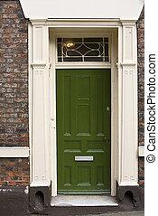 Green Door - Grand green wooden door part of a building,...